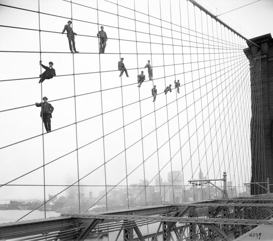 This group of workers suspended from the cables of the Brooklyn Bridge in 1914.