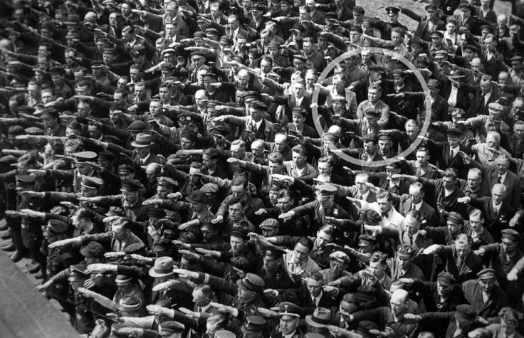 August Landmesser refusing to perform the Nazi salute at a crowded rally.