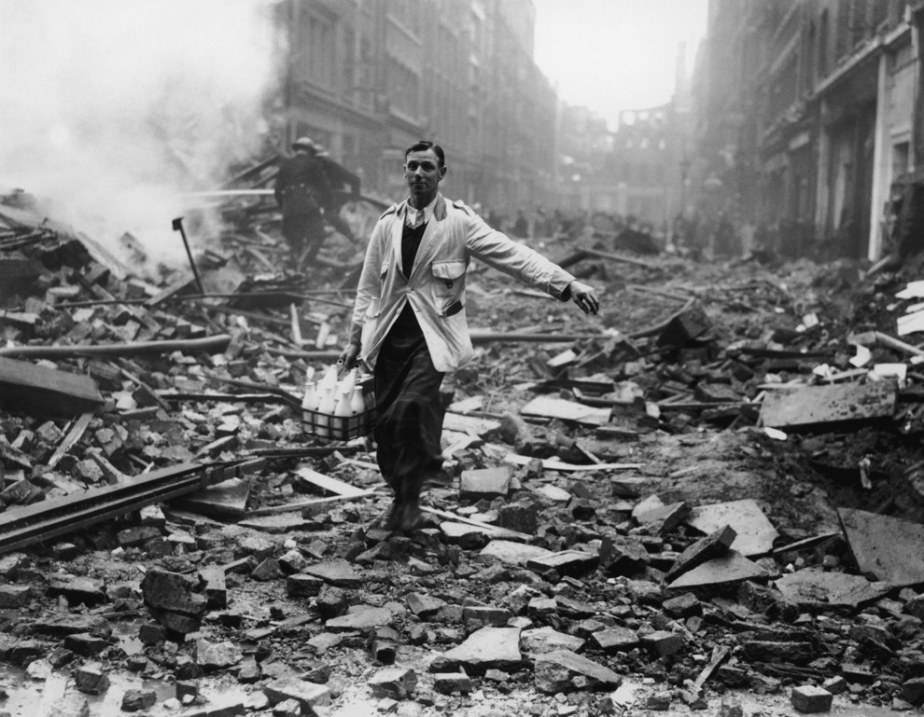A London milkman sticking to his schedule despite the German bombing raid in 1940.