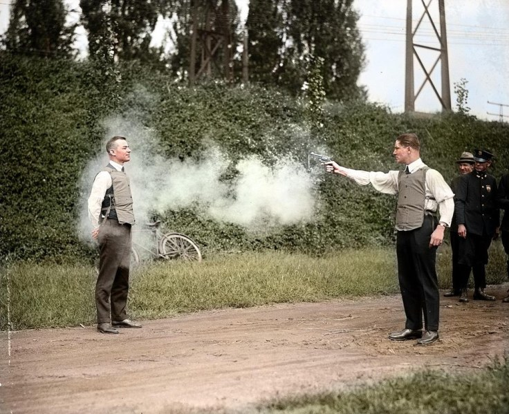 W.H. Murphy and his associate demonstrating their bulletproof vest in 1923.