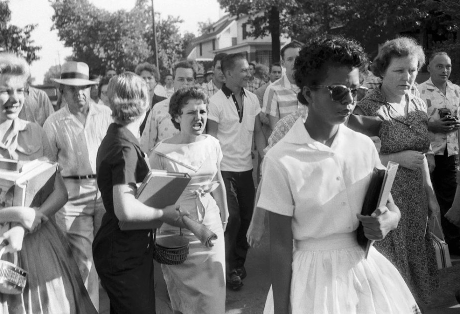 The Little Rock Nine being followed and threatened by an angry white mob in 1957.
