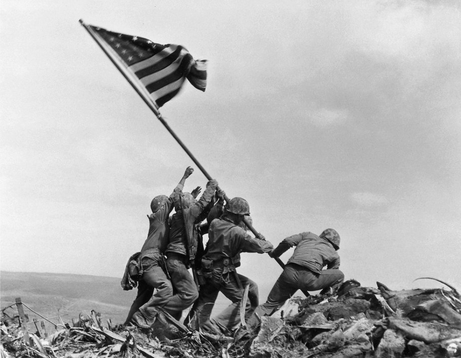 U.S. military raising the American flag on Iwo Jima in February, 1945.