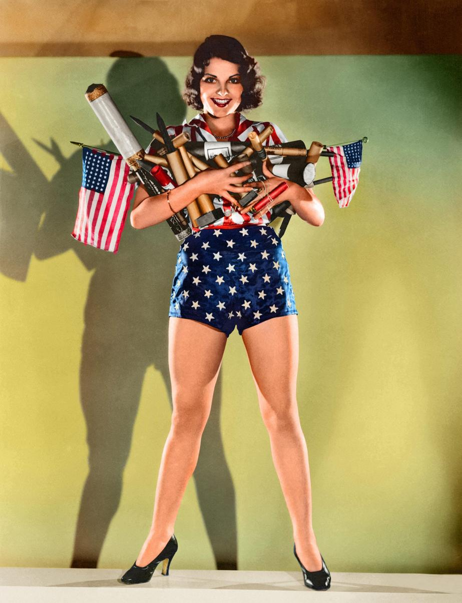 MGM actress Lillian Bond with an armload of fireworks for a Fourth of July celebration, Hollywood, California, circa 1930.